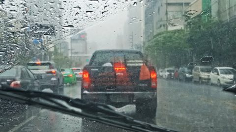 93769163 - blurred car on road in raining, driver view
