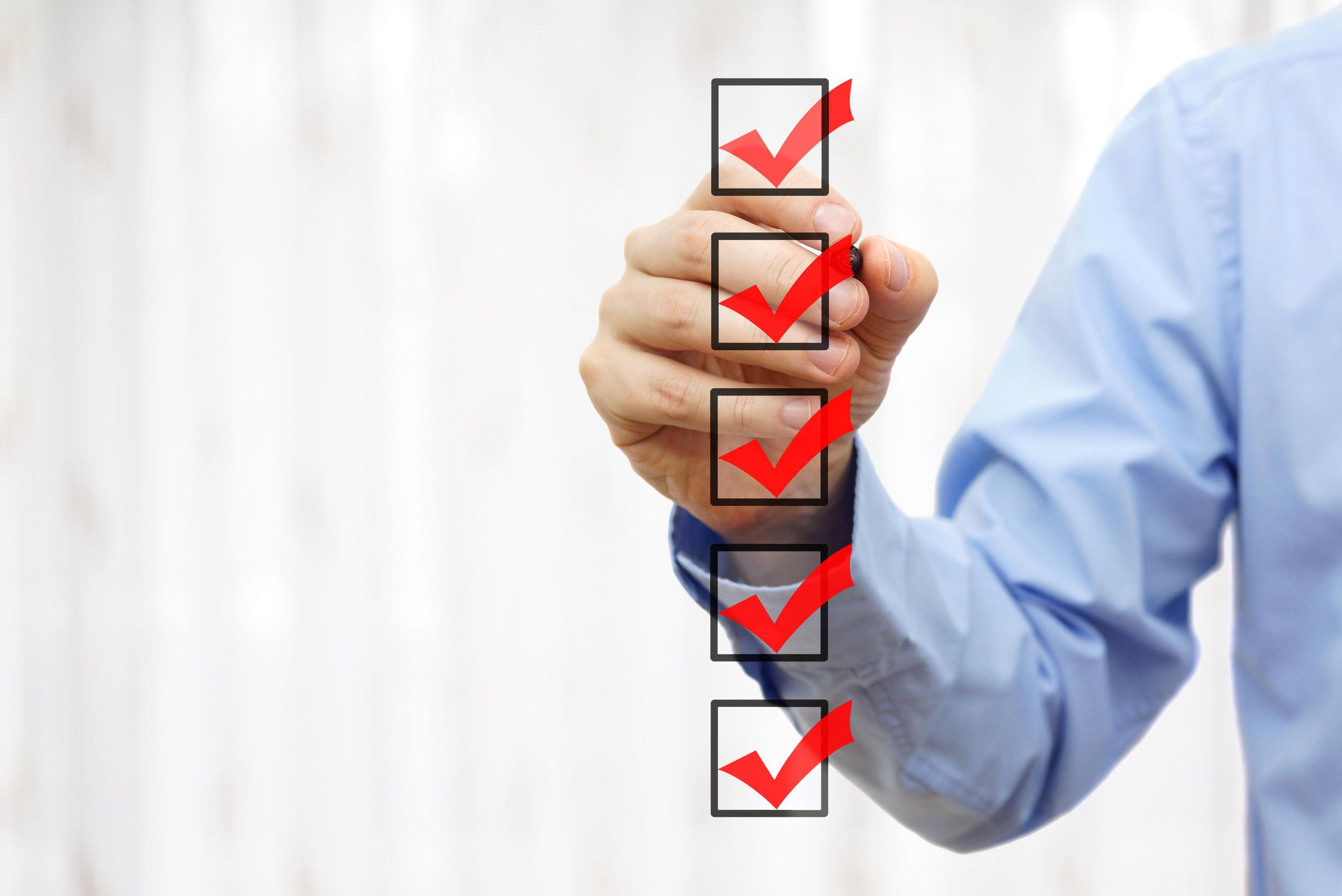 43132471 - businessman checking final mark on checklist
