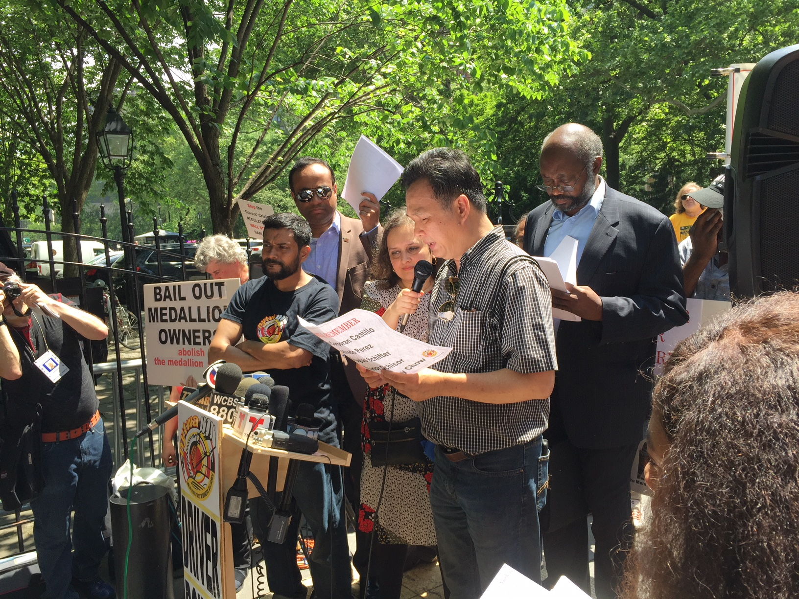 Richard Chow addresses crowd and reporters during press conference. (Photo credit Dave Pollack)